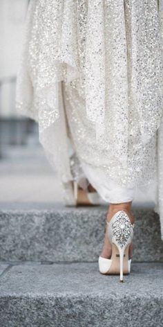Show off your stunning bridal shoes while still incorporating the details of your wedding dress in your wedding photos - especially if your shoes are full of glitter and sequins!