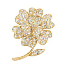 Gold and Diamond Flower Clip-Brooch, Van Cleef & Arpels   18 kt., the flower topped by overlapping pave-set diamond petals, supported by a polished gold stem accented by a diamond-set leaf, totaling 124 round diamonds approximately 8.25 cts., signed Van Cleef & Arpels, N.Y., no. 41843, approximately 10.4 dwts.