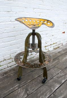 Recycled materials make a bar stool....this is a John Deere Tractor seat....