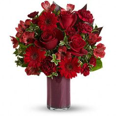 Red Rapture - [T541-1A]  Plunge into the depths of the most ravishingly red bouquet ever - artistically arranged in a chic cylinder vase. Red roses, gerberas, alstroemeria and carnations - get them while they're hot!