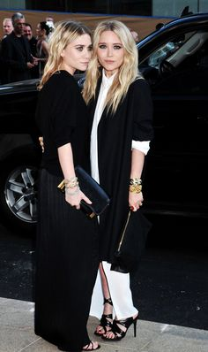 Ashley added a dash of dazzle to her black-on-black look with three diamond bracelets. Mary-Kate layered an oversize black jacket over her white maxi, then slipped on a few animal bangles for the final touch.