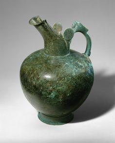 Bronze oinochoe  Period: Archaic Date: mid-6th century B.C. Culture: Greek Medium: Bronze Dimensions: Overall: 13 9/16in. (34.4cm)
