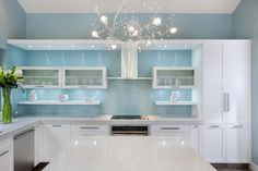 Our contemporary kitchens feature metal or painted cabinets, light woods, Formica counters and tabletops, tile or linoleum floors, and metal dinette sets.