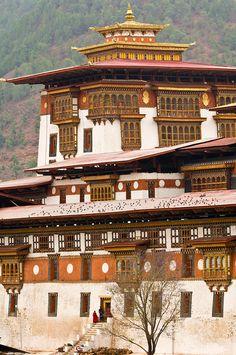 Monks walking aroung Punakha Dzong Monastery fortress, Punakha Valley, Bhutan