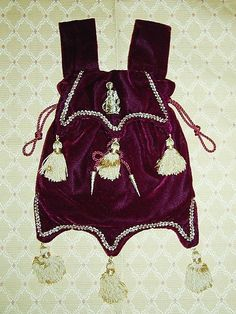 Burgundy velvet pouch with six tassels, based on an effigy at Bakewell Church, Derbyshire>>Was I there with Connie??