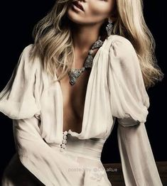 Nude deep neckline blouse with a nod to the medieval era or the era of the pirate. #fashion