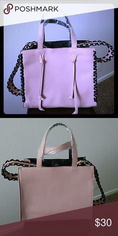 Gorgeous Blush Bag Beautiful blush color with black leather lacing. Wide strap, roomy interior but medium size. Brand new. JustFab Bags Shoulder Bags