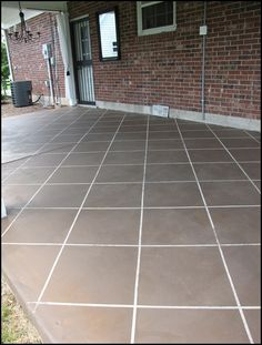 """New """"Tile"""" Patio Floor....stained concrete! Great blog for DIY!"""