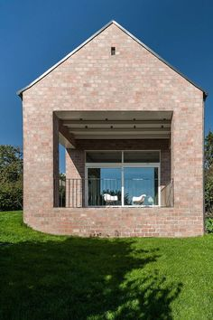 The Long Brick House by Foldes & Co. Architects