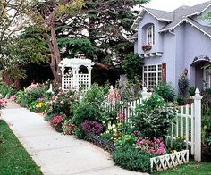 Front Yard Garden Design One day I'll have a white picket fence and a lush garden. - Add beauty and curb appeal to your front yard with a sidewalk garden. Check out these front garden ideas that'll work even in the smallest of spaces. Cottage Garden Design, Cottage Front Garden, Backyard Cottage, Farmhouse Garden, Front Yard Landscaping, Landscaping Ideas, Backyard Ideas, Sidewalk Landscaping, Sidewalk Ideas