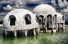 For many years, these bizarre buildings on the isolated southern tip of Marco Island in Cape Romano, Florida, were a bit of a mystery. Some locals and abandoned explorers thought it might have been the community home belonging to a secret cult while other rumours went as far as claiming they had been left behind by extra terrestrials. - domehomeabandoned