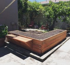 Garden beds made from redwood 2x8s with 4x4 posts and galvanized steel carriage bolts.