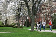Students walk across campus near the Hoyt Hall of Engineering.