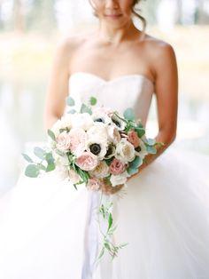 Romantic anemone + ranunculus bouquet: http://www.stylemepretty.com/california-weddings/lake-tahoe-ca/2016/02/01/whimsical-al-fresco-lake-tahoe-wedding-at-the-hideout-inn/   Photography: Coco Tran - http://www.cocotran.com/
