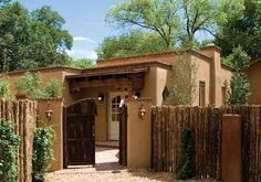 """Woods has clearly mastered Santa Fe's time honored architectural elements and beautiful proportions using indigenous materials, hand-hewn vigas, deep set windows in thick plastered walls and cozy corner """"kiva"""" fireplaces into our traditional homes. Spanish Bungalow, Spanish Style Homes, Spanish Revival, Spanish Colonial, Hacienda Homes, Hacienda Style, Home Design Images, Santa Fe Home, New Mexico Homes"""