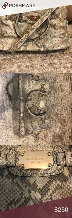 Micheal Kors Bag Snake print with gold hardware. Comes with messenger strap. Handles large enough to hold on shoulders. Lots of room and pockets. Magnetic button closure and zippered middle compartment. Has gold feet on the bottom of bag. In great condition! Michael Kors Bags Satchels