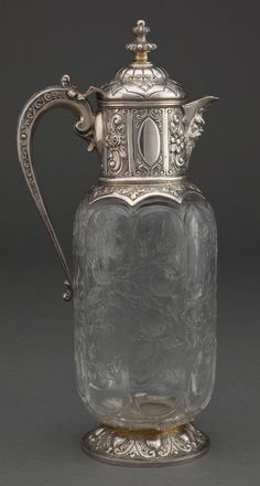 A CHARLES EDWARDS AND STEVENS AND WILLIAMS VICTORIAN SILVER AND ENGRAVED GLASS CLARET JUG . Charles Edwards, London, England, Circa 1891-1892.