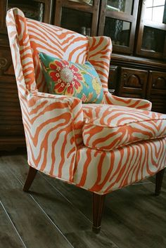 Add second color in orange + cream?  How do I keep the brown chair in the color family, I wonder...