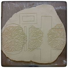 This week I'm working on restocking the one-pound butter dishes so I thought I'd take you on a tour of those steps. Step Three is rolling the doily into the clay where I want the design to show up on the butter dish and then outlining the templates (shown yesterday) and cutting them out.