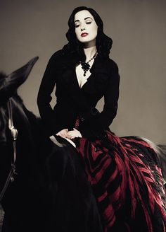 Dita Von Teese. For her beauty, class and courage.