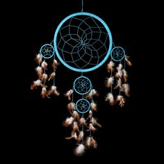 """Dream Catcher - Handmade Traditional Light Blue with Natural Brown & White Feathers 10"""" Diameter & 24"""" long! The Native American dream catcher bedroom decor was intended to protect you from bad dreams while letting good dreams through. Shop our entire gift collection of handmade dream catchers http://www.amazon.com/dp/B00I70NLCY"""