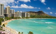 Waikiki Beach, lined with resorts and a magnet for surfers, is sometimes called the world's greatest beach. (From: Photos: 11 Spectacular Destinations You Should Book Right Now)