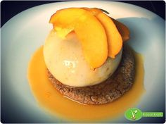 Masala chai pudding on an almond-oat cookie, with orange-caramel and fresh nectarine on it.