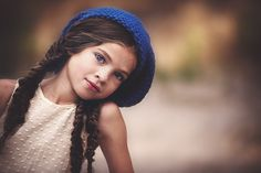 little girl with three braids in her hair