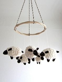 Mobiles aren't just for kid's room décor or baby nurseries. Hang art in any room of your home with t