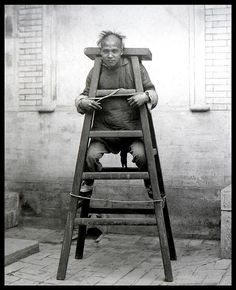 Man demonstrating Chinese torture device