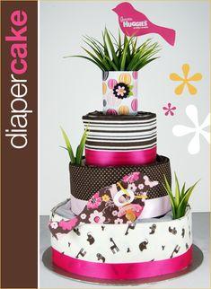 Diaper Cake... diapers, receiving blankets, ribbon, scrapbook paper, faux grass chipboard bird shapes