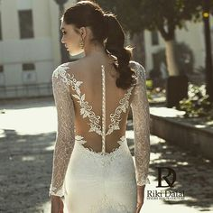 Love at first sight. This gown is part of  Riki Dalal's latest wedding dress collection. Stunning isn't it? @rikidalal_bridalgowns #buttons #lace #weddingdress #instawedding #bride #beautiful #ponytail