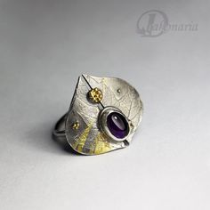 Silver and gold ring with amethyst.