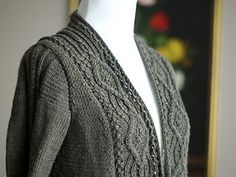 Addington is an v-neck cardigan with a cabled front band. It can be worn open with closed with a shawl pin.