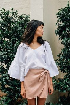 Oh so chic in ruffles and a tulip skirt.