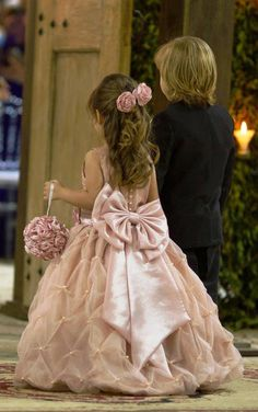 Beautiful pale pink flower girl dress with oversized bow!