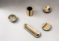 This series of small brass objects has been created as an examination of the borderland between minimalist sculpture and useful everyday objects. Each piece is cast from solid brass, bronzed and the polished. Even though the pieces seem to be all about material and shape, they all have functional elements as office desk top accessories - paper weight, paperclip container, pen holder, table lamp, iPhone holder.