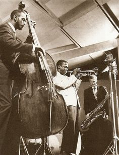 Newport Jazz Festival (1955)  Percy Heath, Gerry Mulligan, and Miles Davis making musical history.