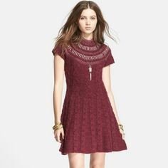 Free People | Nordic Nights Dress Cable knit flare sweater dress with a high round neck, and sequin and metallic accent features. Free People Dresses