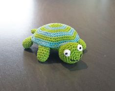 This is a pattern for a small stuffed tortoise, about 14 cm long. Yarn/ thread in two colors is needed: blue and green. Also a little bit of black and white thread and stuffing. Crochet Toys, Free Crochet, Knit Crochet, Crochet Turtle, Yarn Thread, Knitting Needles, Tortoise, Free Pattern, Dinosaur Stuffed Animal