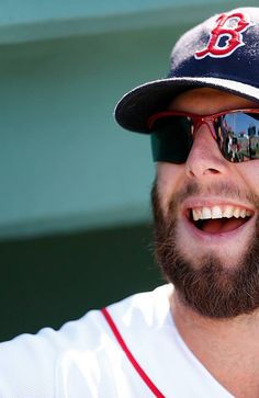 BOSTON, MA - AUGUST 17: Dustin Pedroia #15 of the Boston Red Sox smiles as he chats with fans before a game with the New York Yankees at Fenway Park on August 17, 2013 in Boston, Massachusetts. (Photo by Jim Rogash/Getty Images)