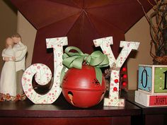 Joy wood letters with bell