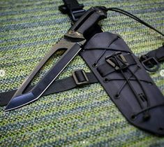 integrity implements Kugeki DE KuTac in 5160 steel, satin black finish, hollowgrind and CF scales custom hand made knife - Messer Hidden Weapons, Weapons Guns, Cool Knives, Knives And Swords, Tactical Knives, Tactical Gear, Kydex Holster, Weapon Concept Art, Things To Buy
