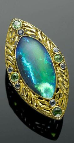 An Antique Black Opal, Demantoid Garnet and Sapphire Ring, Lightning Ridge, New South Wales, Australia, Circa 1905. via Bonhams