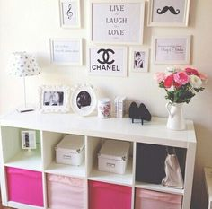 Cube shelving with frame collage above in office/make up room