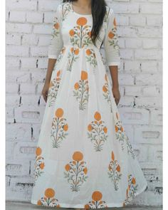 Buy The Secret Label White Tangerine floral maxi online in India at best price.Block printed maxi in mul cotton fabric. It comes with a round neckline and has box pleats around the Western Dresses, Indian Dresses, Indian Outfits, Kurta Designs, Dress Designs, Frock Fashion, Fashion Dresses, Fashion Pants, Cotton Gowns