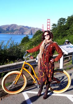 Nice fall outfit for biking. Beautiful orange bike, autumn colors in dress, brown tights, browne shoes.