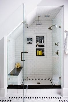 white subway tile shower stall with seating