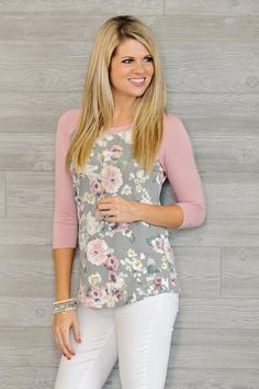 You will look so pretty in pink in our trendy floral baseball top! Fit is true to size. Material: 55% Polyester, 40% Rayon, 5% Spandex SIZING INFO: This is our