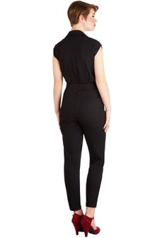 Annabelle's Caught Your Eye Jumpsuit. If the classic silhouette, urban feel, and sexy black tone of this collared jumpsuit put a sparkle in your eye, you certainly arent alone. #black #modcloth
